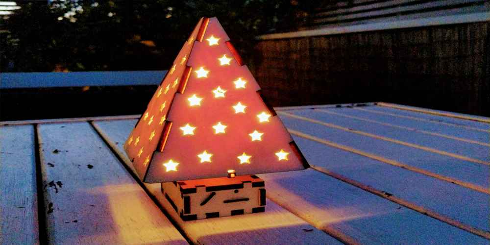 A wooden Christmas Tree sparkles with LED lights